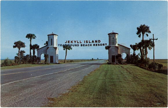 Jekyll highway gate with banner, &ldquot;Jekyll Island Year Round Beach Resort&rdquot;